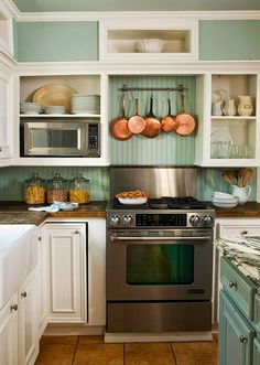 Cottage Kitchen Backsplash -- Love the blue-green beadboard paired with the copper pots, warm wood countertops and terracotta floor tiles. Cottage Kitchen Backsplash, Kitchen Backsplash Inspiration, Cozy Kitchen, Kitchen Redo, New Kitchen, Kitchen Remodel, Kitchen Dining, Kitchen Ideas, Kitchen Stove