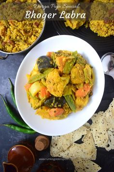 Labra recipe aka bengali labra is an exemplary and inimitable Bengali mixed vegetable curry which is prepared in puja festivals like Durga Puja, Laxmi Puja, Saraswati puja etc. and offered to the Goddesses as Prasad. In this preparation, array of vegetables are cooked with panch phoran and Bengali bhaja masala in mustard oil. It is mostly accompanied with bhoger khichuri but can also be paired up with steamed rice or flat bread like Roti, luchi etc.