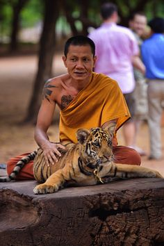 A monk and his tiger friend.