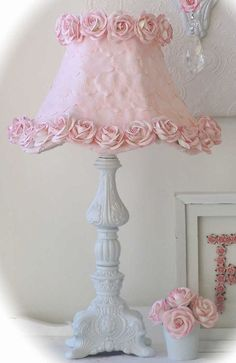Candlestick, Michael's ability to wire a lamp, simple lampshade, pink fabric and a lot of time to make fabric flowers