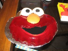 Elmo Jello Cake--I hate red icing, so when my son wanted an Elmo birthday cake I decided to use Jello instead.  Then used Wilton candy melts and icing color for the eyes, nose and mouth.  The kids loved it!