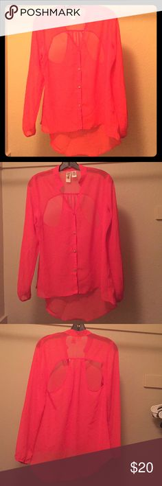 Sheer blouse in orange with fun cut outs in back Sheer orange blouse with long sleeves and fun cut outs in the back. Longer in back with open Peter Pan collar. Barely worn. No longer fits so that's why no pictures of it on. Tops Blouses