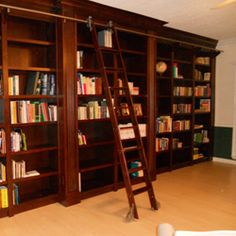I love this kind of stuff, I like it even better when I can buy the parts and make it myself.  Rolling Library Ladder