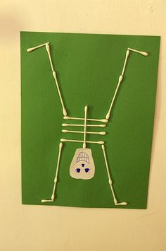 Q tip skeletons... might be the craft at our Halloween party in a couple weeks!