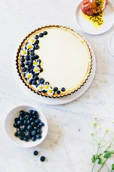 passionfruit and blueberry cream tart - hummingbird high || a desserts and baking blog . I'm mostly pinning this for the very odd browned butter crust. And because the top of the pie is so darn cute. :)