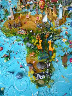 Sara Drake - 3d illustrated world maps made from mixed media, including papier mache, balsa wood, acrylic paint, beads and wire. All details are hand made and to commission. Each map is personalised with the details of the client's own travels.