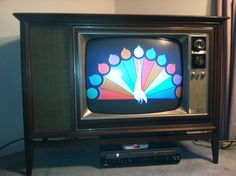 1966 Zenith 25 inch color TV with a Danish modern cabinet