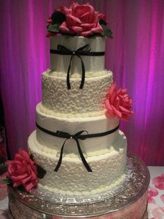 My most popular wedding cake. Buttercream with real ribbon and flowers.