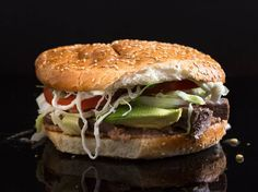Cemitas are a type of Mexcian sandwich that originally hails from the State of Puebla, but they've taken on a life of their own in New York City. This recipe creates a cemita sandwich as served in the restaurants and taco trucks of New York, in particular along Roosevelt Avenue in Jackson Heights. These are gently warmed sandwiches served on a griddled sesame bun with taco-meat fillings of your choice, avocado, lettuce, tomato, chipotles, refried beans, mayo, and queso Oaxaca, a Mexican…