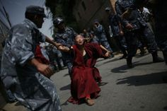 30 March A Tibetan Buddhist nun is forcibly detained by police during a pro-Tibetan protest outside the Chinese consulate in Kathmandu, Nepal Tibet, Buddhist Nun, Dalai Lama, 50th Anniversary, The Guardian, Human Rights, Buddhism, Culture, United Nations