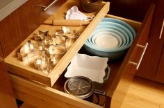 Never let a deep drawer swallow up your holiday cookie cutters or cupcake papers again. This slim rollout hovers above another drawer, sharing the same drawer face and hardware.