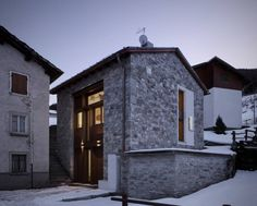 Contemporary brick with wood and glass façade. UP house by Enrico Scaramellini Architetto