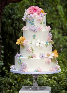 3. Pastel flowers add whimsy to this sweet four-tiered white wedding cake. Check out these 10 Prettiest Spring Wedding Cakes.