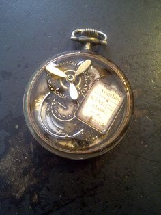 Layered items in a vintage watch casing, from B'sue....Will have to see if I don't have a photo of the completed piece!