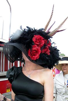 This classic oversized Derby hat shows an amazing sense of flair. There were plenty of hats decorated with roses and feathers, but this one pulls them togeether with incredible style.