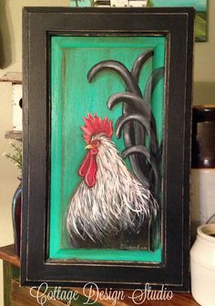 This is a solid wood cabinet door panel, I have hand painted this piece with a sassy rooster and he is striking and beautiful on this emerald background color! I Love this piece! The edges are distressed for a touch of timeworn appeal. This piece measures 22 inches tall and is 13 1/2 inches wide. It has been signed dated and sealed for protection and is ready to hang and enjoy. Perfect to enhance any farmhouse kitchen style, French Country decor, Country Chic to any Traditional style of…