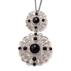 Two piece delicate pendant in sterling silver and jet, handmade in Galicia, with traditional methods. Artcraft of The Way of Saint James. Tax free $189.90