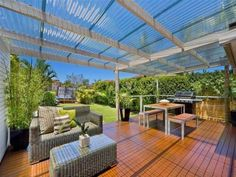 Using clear laserlight roofing over the pergola/deck lets in the sunshine and light all year round.#laserlightroofing #roofing #pergola #deck