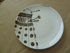 Exterminate your dinner! Dalek drawn on a plate with a porcelain pen. -sakacon
