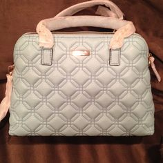 """Kate Spade Baby Blue Satchel Chain embellished double handles with 8"""" drop Zip around closure with leather pull Inside fabric lining with 1 zip pocket , 2 slip pockets 14.5"""" L X 10.5"""" H X 5"""" D . Crossbody drop 19"""" kate spade Bags Satchels"""