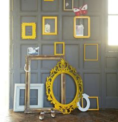 Customise frames 'This is an easy way to inject energy into your home. Remove the glass panes from of a collection of new and old frames and spray-paint the frames – I picked bright yellow. It makes a striking wall display in a hallway or living room. Don't worry if the paintwork is a bit patchy, it adds to the look. You could add plain frames for contrast. Experiment with colour combinations – yellow works well against this dark grey wall.'