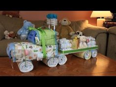 My quick video idea on how to make a cool looking Semi Truck Diaper Cake. Suprise your friends with a cool 18-Wheeler baby shower gift! Just another fun idea to try at the next baby shower you may go to. Give it a try! Thank so much for watching!            All Music is Royalty Free and Self Owned and Created with Sony ACID music software.    Semi Truck...