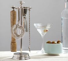Based on the timeless elegance of French champagne buckets, our radiant Harrison Bar Tool Set comes displayed on a compact rack and brings the style and practicality of professional bar tools into your home. Use these tools to prepare cocktails to… Home Bar Decor, Bar Cart Decor, Home Bar Accessories, Bar Spoon, Classic Bar, Champagne Buckets, Stainless Steel Bar, Man Cave Bar, Metal Bar