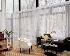 Hunter Douglas Canada - Luminette Privacy Sheers marry the beauty of sheers with the privacy of soft draperies. Available in a side or split stack design, these vertical sheer window treatments are especially suited for larger, rectangular windows and sliding glass doors.
