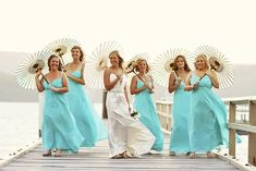 Google Image Result for http://phoenixweddingalterations.com/wp-content/uploads/2012/05/Beach-Wedding-Bridesmaids.jpg great idea to keep the girls cool