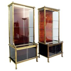 Pair of 1950s Showcases/Vitrines Attributed to Maison Jansen | From a unique collection of antique and modern vitrines at https://www.1stdibs.com/furniture/storage-case-pieces/vitrines/