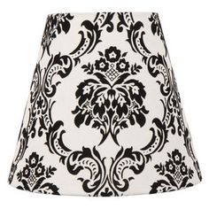 I have two of these lamp shades on both sides of the bed. They are soo cute with a classic design that pulls the old and new together.