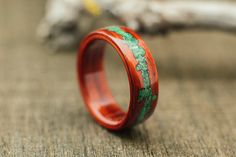 Bentwood ring, padouk wood ring with crushed malachite stone inlay by SomedayInSeptember on Etsy https://www.etsy.com/listing/224447288/bentwood-ring-padouk-wood-ring-with