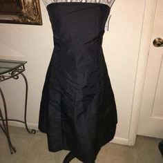 H&M Black tea length dress NWT Brand new!!! NWT H&M dress. May smell dusty from being in the closet (I can't tell because I've been digging back there so long). Very cute! Lost weight and can't fit into it. H&M Dresses Strapless