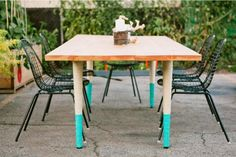 We need new-used dining room chairs, it might funk them up to paint their legs like this table.