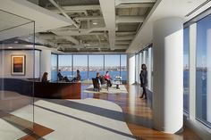 Ocean and city views are highlighted by unobstructed large windows and an open circulation pattern in this office design. Workplace design. Designed by BH+A.