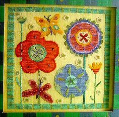Summer Garden is the title of this cross stitch pattern from Birds of a Feather that features these beautiful and colorful flowers from a su...
