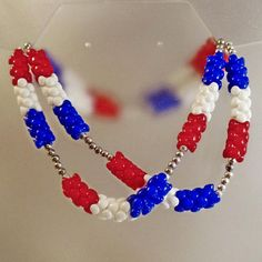 This #vintage long patriotic necklace is fabulous!  This red white blue stacked bead necklace is gorgeous!  It features a series of stacked puzzle piece style red, white and... #ecochic #etsy #jewelry #jewellery