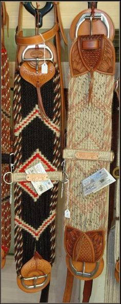 Handcrafted mohair cinch safes, or ware leathers, are made by Sage Creek Stock Saddle Co..  The cinches here are made by Darin Alexander of Art Cords, LLC.  They produce their own superior cordage which they offer for sale.