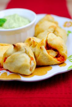 Buffalo Chicken Poppers with Avocado Bleu Cheese Dip  Ingredients: 4oz cream cheese, softened (can use regular, whipped, 1/3 less fat, etc.) 3 teaspoons ranch dip mix, divided 1 large chicken breast, cut into small pieces 3-4 Tablespoons buffalo wing sauce 1, 8-count tube reduced fat crescent rolls  Avocado Bleu Cheese Dip 1 avocado 1/3 cup bleu cheese dressing