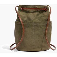 MADEWELL The Convertible Canvas Backpack (905 ZAR) ❤ liked on Polyvore featuring bags, backpacks, british surplus, canvas daypack, drawstring backpack, bucket bags, brown canvas backpack and monogrammed backpacks