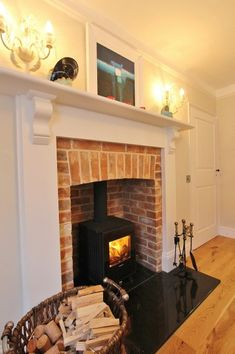 Bring whole the family together in this stunningly renovated Georgian cottage in the centre of Blakeney. Discover more about this beautiful cottage here. 1930s Fireplace, Country Fireplace, Cottage Fireplace, Stove Fireplace, Georgian Fireplaces, Snug Room, 1930s House, Paint Colors For Living Room, House Smells