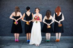 Four bridesmaids with different black dresses & colored shoes... Groomsmen have ties to match shoes.