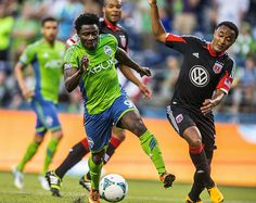 Obafemi Martins beats former Sounder James Riley for position and hits his second goal of the evening against D.C. United. (Photo by Dean Rutz / The Seattle Times)