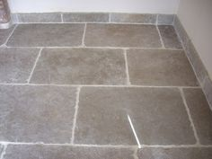 Umbrian Limestone. The stone has been cleverly cut to be used as skirting.