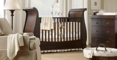 Love the simplicity of this room, and that crib is really beautiful. I like that its not a traditional crib!