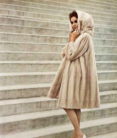 Model in Tourmaline EMBA hooded mink coat by Christian Dior, photo by Georges Saad, 1961