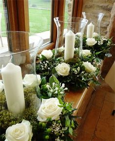 table centres - like the green berries, the pine cones, the ivy, would go for champagne roses and heather or amnesia roses.