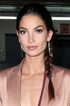 Who: Lily Aldridge What: An Evening Braid How-To: It's easy to overthink braids—especially for nighttime or the red carpet—but the model's simple, sleek take is a perfect example of less being more. Run a shine serum through straight hair, weave it into a tight, low side braid and tie it off with a mini elastic—no frills or fuss required. Editor's Pick: Victoria's Secret High-Shine Serum, $14, victoriassecret.com. - HarpersBAZAAR.com