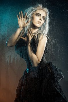 'A Storm is Coming'. Mark O'Grady Photography, Stephy H model. Rain photoshoot steam  condensation creative glass water droplets dreadlocks blonde white silver hair trapped longing