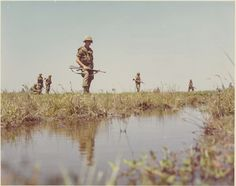 Rice paddies, marshlands, and other shallow water features were a daily problem for many troops on patrol. Other soldiers marched through jungles, hills, and mountainous terrain in search of communist forces. Vietnam Map, Vietnam War Photos, South Vietnam, Vietnam History, Vietnam Veterans, These Broken Stars, We Are The Mighty, Mountainous Terrain, Army Soldier